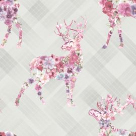 A grey tartan background with stags made out of pink floral patterns in the foreground.