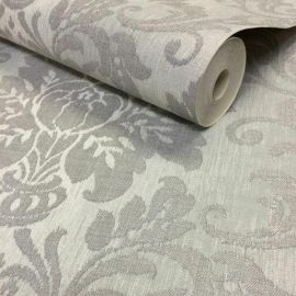 A fabric-style wallpaper with a light silver background and a darker silver glittering damask pattern on top.
