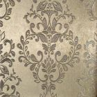 A gold wallpaper sample with an embossed leafy damask pattern on top.