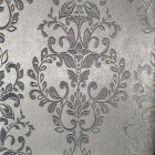 A wallpaper sample with a silver metallic background and an embossed damask leaf pattern on top.